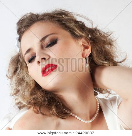 Beautiful young girl with eyes closed