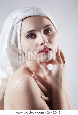 Young beautiful girl in the sauna towel