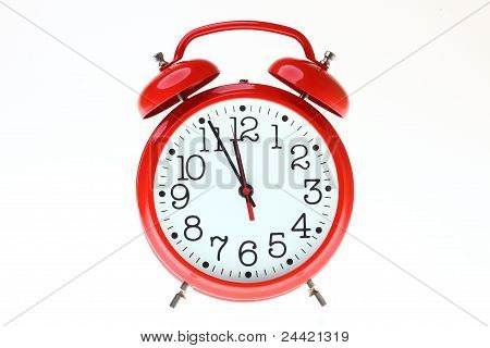 red old style alarm clock isolated