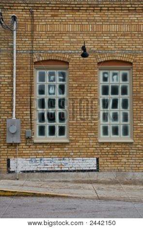 Windows In A Brick Wall
