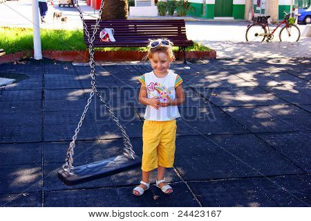 The girl near a swing