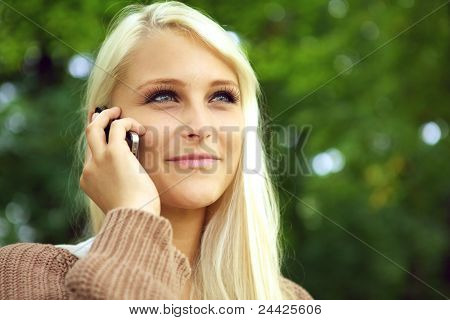 Radiant Young Woman On Mobile Phone