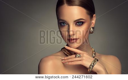 2d782fc9498 Poster of Beautiful Girl With Set Jewelry . Woman In A Necklace With A Ring,  Earrings And A Bracelet. Beauty