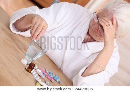 Elderly woman with various medications