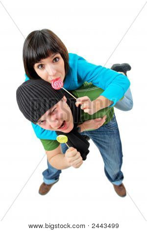 A Girl And A Boy With Lollipops