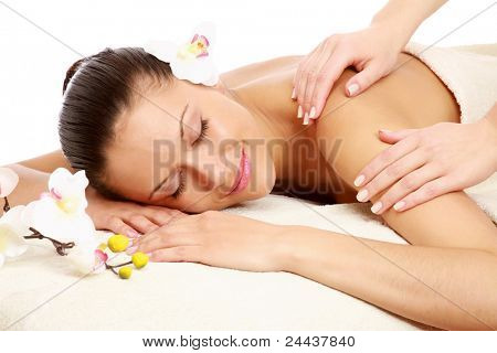 A beautiful woman getting massage in a spa center