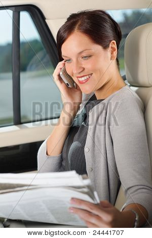Executive Woman Manager Sitting In Car Calling