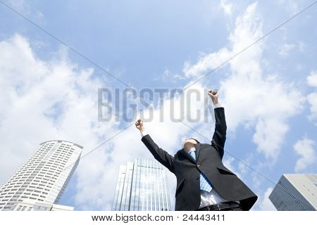 Businessman who raises one's arms