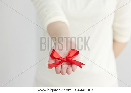 Red ribbon put on hand