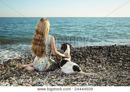Beautiful Woman With A Dog On The Beach