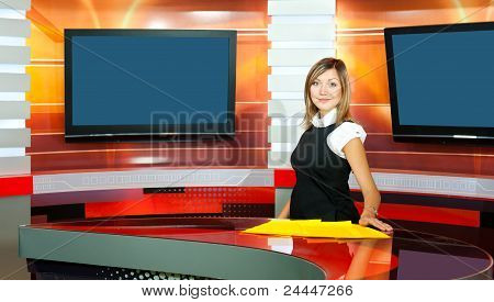 Pregnant Television Anchorwoman At Tv Studio