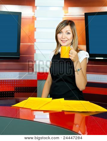 Television Anchorwoman Has Coffee Break