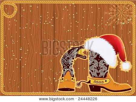 Billboard Frame With Cowboy Boots And Santa's Red Hat On Wood Wall