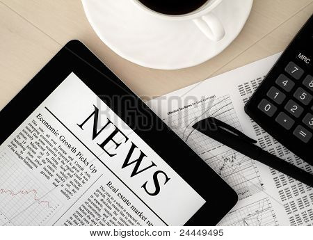 Apple Ipad With News On Desk