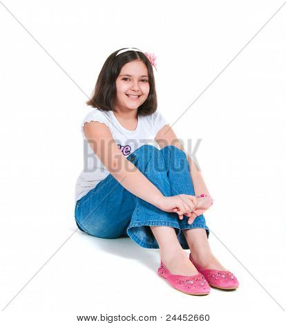 The Girl Sits On A White Background