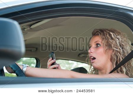 Typing Sms While Driving Car