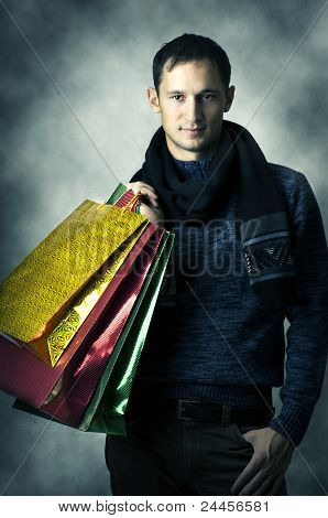 Portrait Of Young Man With Shopping Bags