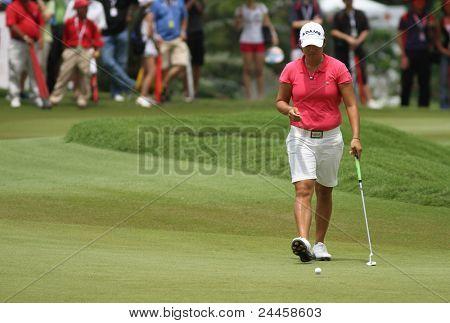 KUALA LUMPUR, MALAYSIA - OCTOBER 16: Yani Tseng of Chinese Taipei prepares to putt at the green of hole #18 at the Sime Darby LPGA 2011 golf tournament on Oct 16, 2011 in Kuala Lumpur, Malaysia.