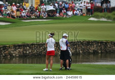 KUALA LUMPUR, MALAYSIA - OCTOBER 16: Sandra Gal of Germany waits for her turn on the fairway of hole #18 during the Sime Darby LPGA 2011 golf tournament on Oct 16, 2011 in Kuala Lumpur, Malaysia.