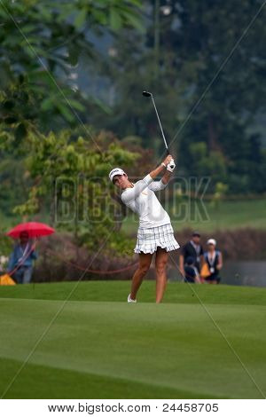KUALA LUMPUR, MALAYSIA - OCTOBER 16: Azahara Munoz of Spain watches her shot from the fairway of the KL Golf & Country Club at the Sime Darby LPGA 2011 on October 16, 2011 in Kuala Lumpur, Malaysia.