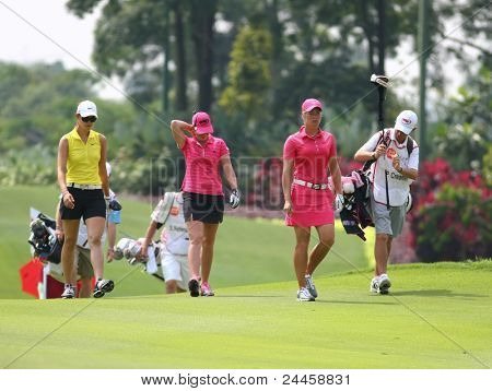 KUALA LUMPUR, MALAYSIA - OCTOBER 16: Michelle Wie (left), Paula Creamer and Suzann Pettersen (right) walk to the green at the Sime Darby LPGA 2011 golf event on Oct 16, 2011 in Kuala Lumpur, Malaysia.