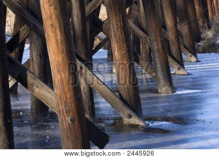 Wooden Railroad Trestle Across A Frozen River
