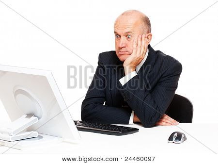amazed businessman looking on monitor over white background