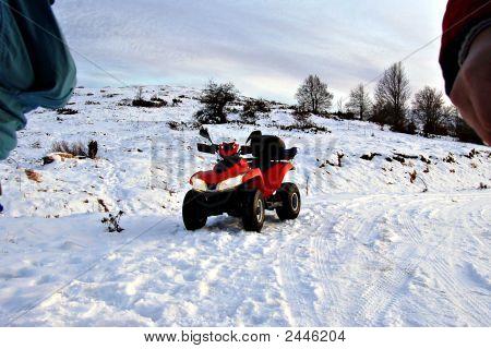 Red Quad In Snow