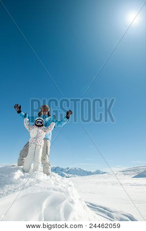 Skiing, skiers having fun on winter holiday (space for text, cover)