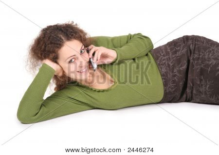 Young Woman Lie And Talk On The Cell Phones On White