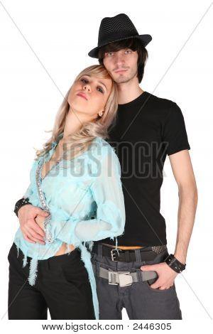 Boy In Black Hat Embraces Girl In Cyan Blouse
