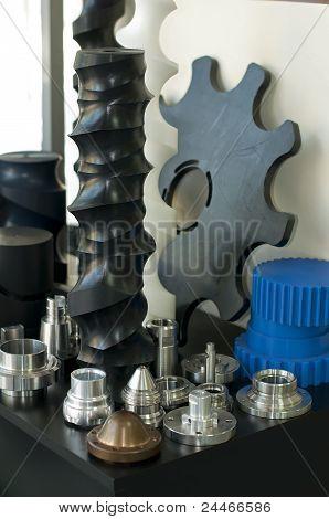 Plastic And Metal Machine Parts. Vertical Imagel