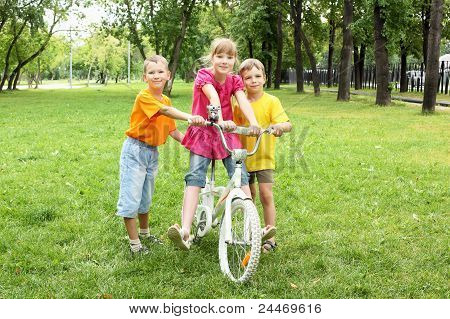 Girls with a bike in the park