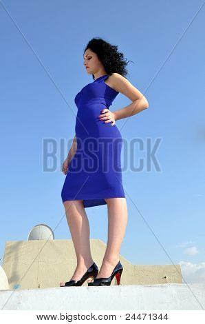 Portrait Of A Beautiful Woman Agains Blue Sky