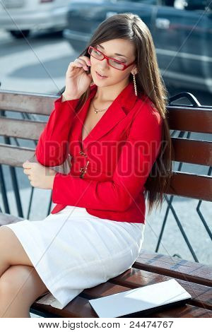 businesswoman  calling by phone outdoors