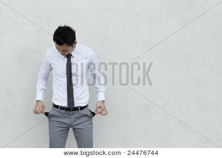 Asian Businessman With Empty Pockets
