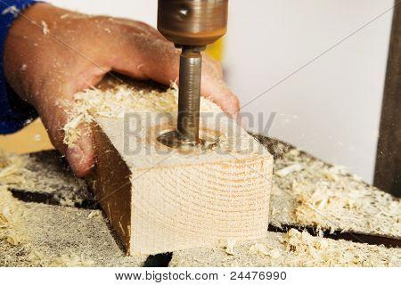 carpenter at a drill