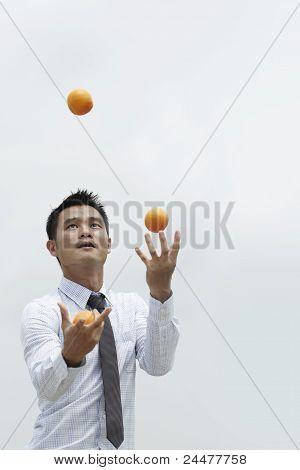 Asian Business Man Juggling
