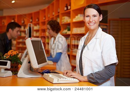Smiling Pharmacist At Computer
