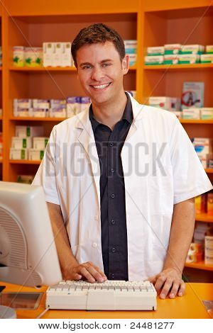Smiling Pharmacist Behind Counter