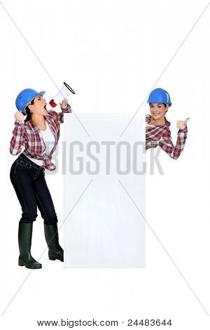 craftswoman shouting in loudspeaker and twin sister