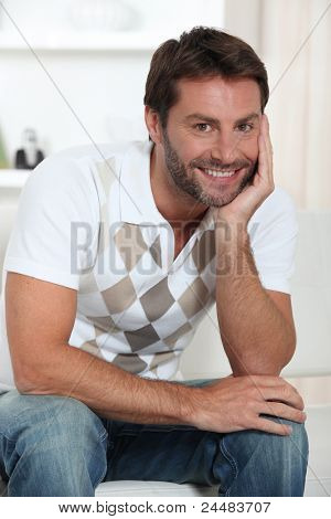 Smiling man relaxing in his living room