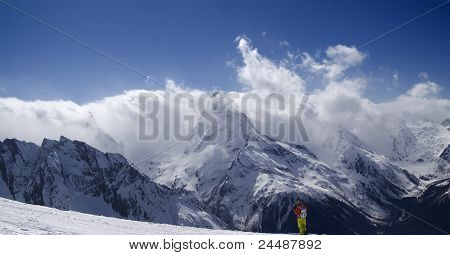 Panorama Mountains. Ski Slope With Skier.