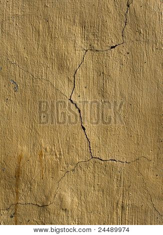 Cracked Yellow Plaster Wall
