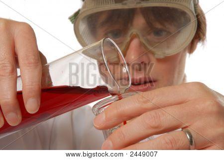 Confident Lady Technician Pouring Liquid