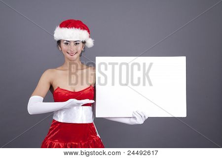 Asian Woman In Christmas Costume With A Blank Sign