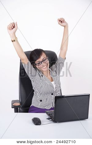 Happy Businesswoman With Her Laptop
