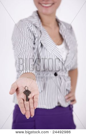 Smiling Woman Offering A Key