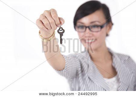 Smart Businesswoman With A Key