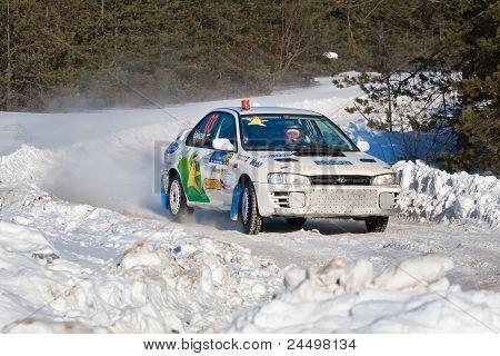 Rostov, Russia - Fubruary 07: Vasiliy Sedov Drives A White Subaru Impreza Car During Rostov Velikiy